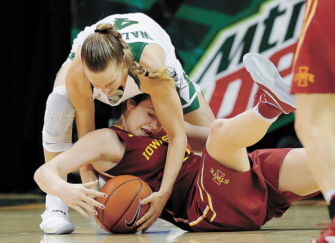AP PHOTO • Baylor's Kristy Wallace and Iowa State's Bridget Carleton, bottom, compete for a loose ball in the second half of a Big 12 Conference basketball game Wednesday in Waco, Texas.