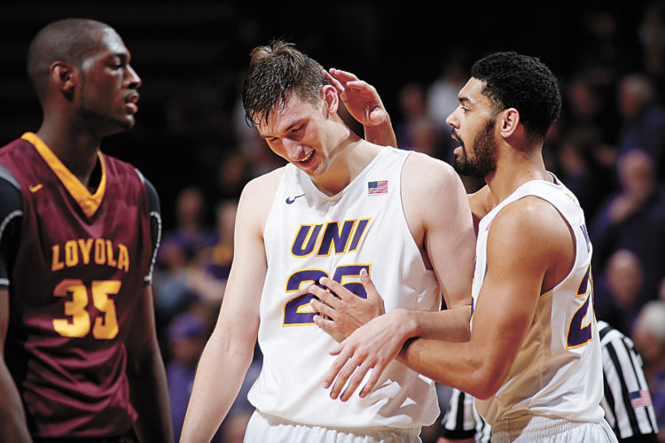 AP PHOTO • Northern Iowa's Jeremy Morgan, right, congratulates Bennett Koch, center, after he was fouled in overtime during a Missouri Valley Conference basketball game against Loyola on Wednesday night at the McLeod Center in Cedar Falls.