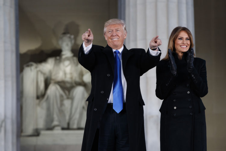 """AP PHOTO President-elect Donald Trump, left, and his wife Melania Trump arrive to the """"Make America Great Again Welcome Concert"""" at the Lincoln Memorial, Thursday, in Washington."""