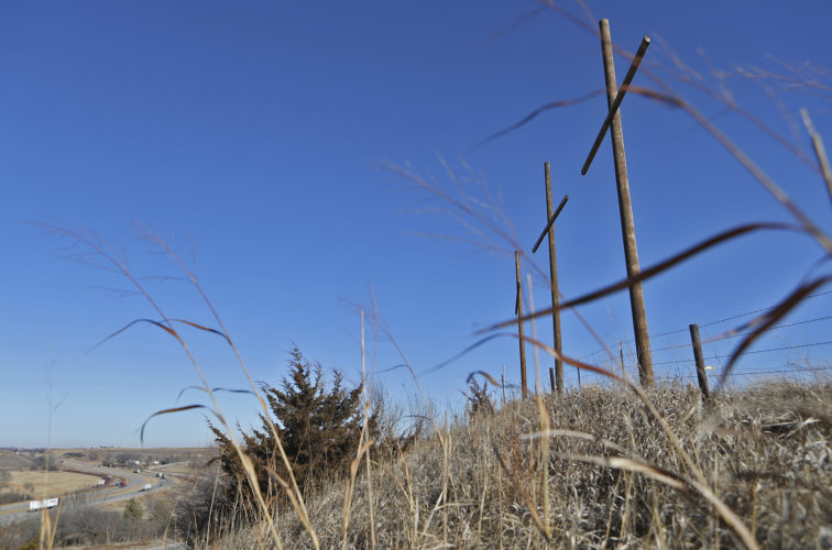 AP PHOTO In this Wednesday photo, a trio of 36-foot-tall wooden crosses, erected by members of the Neola Lions Club, overlook Interstate 80 just off exit 23 near Neola. The club was inspired to build the crosses when it learned about Crosses Across America, a nonprofit organization that has helped erected more than 2,000 clusters of crosses across the country.