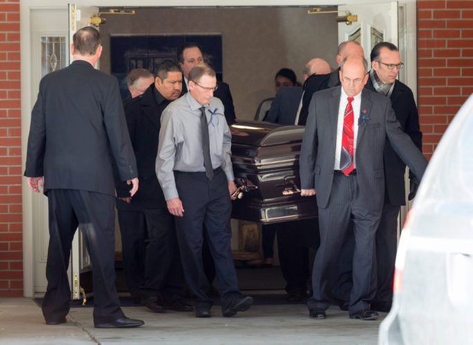 AP PHOTO Pallbearers bring out the casket during the funeral for Michael Oehme, Wednesday, in Council Bluffs. Oehme was killed in the Jan. 6 shooting at the Fort Lauderdale-Hollywood International Airport, in Fort Lauderdale, Fla.