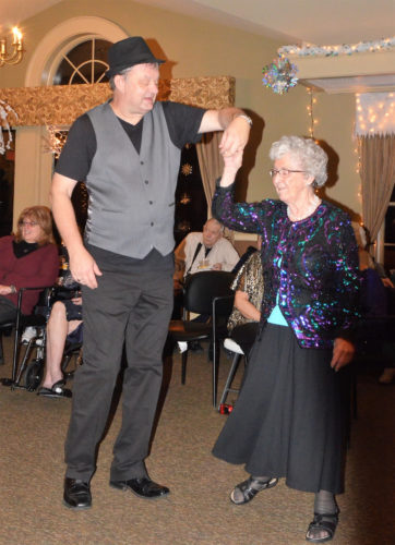 T-R PHOTO BY CHUCK FRIEND Oak Estates tenant Bonnie Davis shares a dance with staff member Lynn Gieken during the 14th annual Snowflake Ball in Conrad.