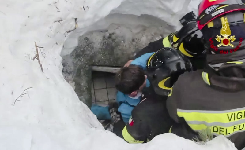 AP PHOTO This frame from video shows Italian firefighters extracting a boy alive from under snow and debris of an hotel that was hit by an avalanche on Wednesday, in Rigopiano, central Italy, Friday.