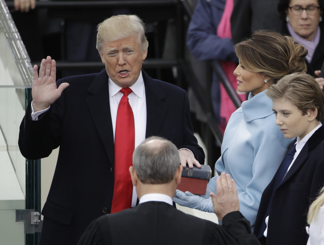 AP PHOTO Donald Trump is sworn in as the 45th president of the United States by Chief Justice John Roberts as Melania Trump looks on during the 58th Presidential Inauguration at the U.S. Capitol in Washington, Friday.