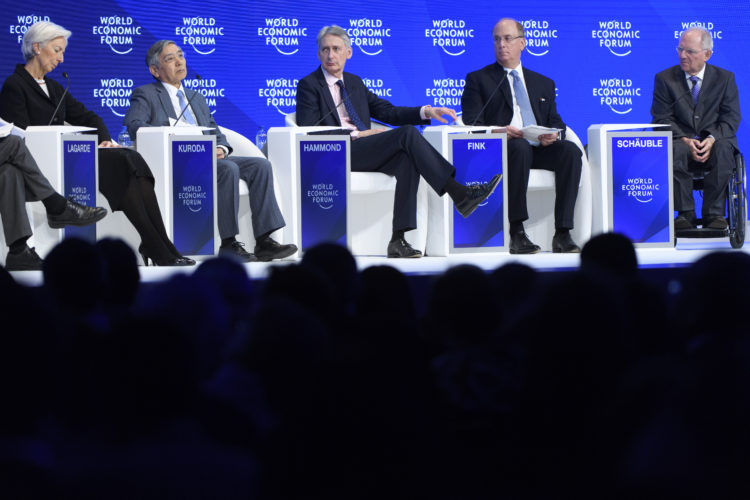 AP PHOTO From left, France's Christine Lagarde, Managing Director of the International Monetary Fund, IMF, Bank of Japan Governor Haruhiko Kuroda, British Treasury Chief Philip Hammond, Laurence D. Fink, Chairman and CEO of BlackRock Inc. and German Finance Minister Wolfgang Schaeuble attend a plenary session during the closing day of the 47th annual meeting of the World Economic Forum, WEF, in Davos, Switzerland, Friday.