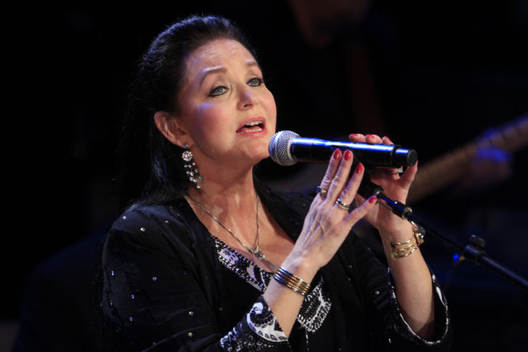AP PHOTO In this Oct. 21, 2012 file photo, Crystal Gayle performs at the Country Music Hall of Fame Inductions in Nashville, Tenn. Country music legend Gayle is being inducted into the Grand Ole Opry in Nashville.