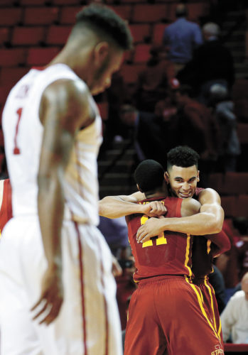 AP PHOTO • Iowa State guard Nazareth Mitrou-Long, right, hugs teammate Monte Morris as Oklahoma State guard Rashard Odomes (1) walks off the court following Saturday's Big 12 Conference basketball game in Norman, Okla. Iowa State won in double overtime 92-87.