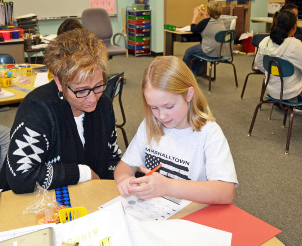 T-R PHOTO BY SARA JORDAN-HEINTZ Ella Spitzli, 8, a fourth grader at Franklin Elementary School, excels at everything she sets her mind to, and harbors a love of learning. Teacher Shelly Kluver, left, said the student is always prepared to meet a challenge.