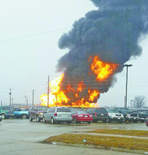 T-R PHOTO BY MARK JORGENSEN AT LEFT: This past Saturday morning, a giant fireball and smoke erupted from the JBS methane lagoon in the 800 block of East Marion Street. Streets in a several block radius were blocked off as the Marshalltown Fire Department fought the blaze.
