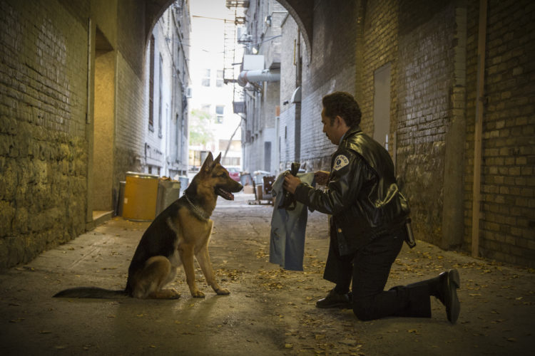 "This image released by Universal Studios shows John Ortiz in a scene from ""A Dog's Purpose."" (Joe Lederer/Universal Studios via AP)"