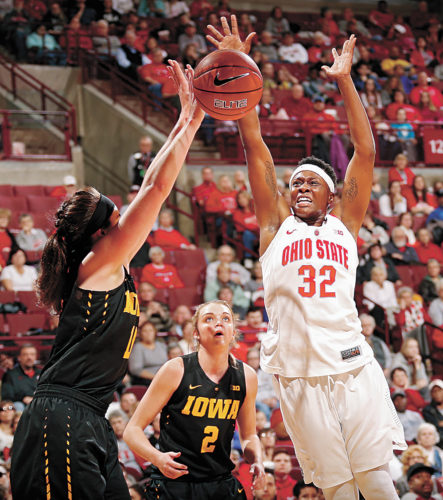 AP PHOTO • Ohio State forward Shayla Cooper (32) and Iowa forward Megan Gustafson (10) go for a rebound during the first quarter of a Big Ten Conference basketball game Sunday in Columbus, Ohio. The 13th-ranked Buckeyes won 88-81.