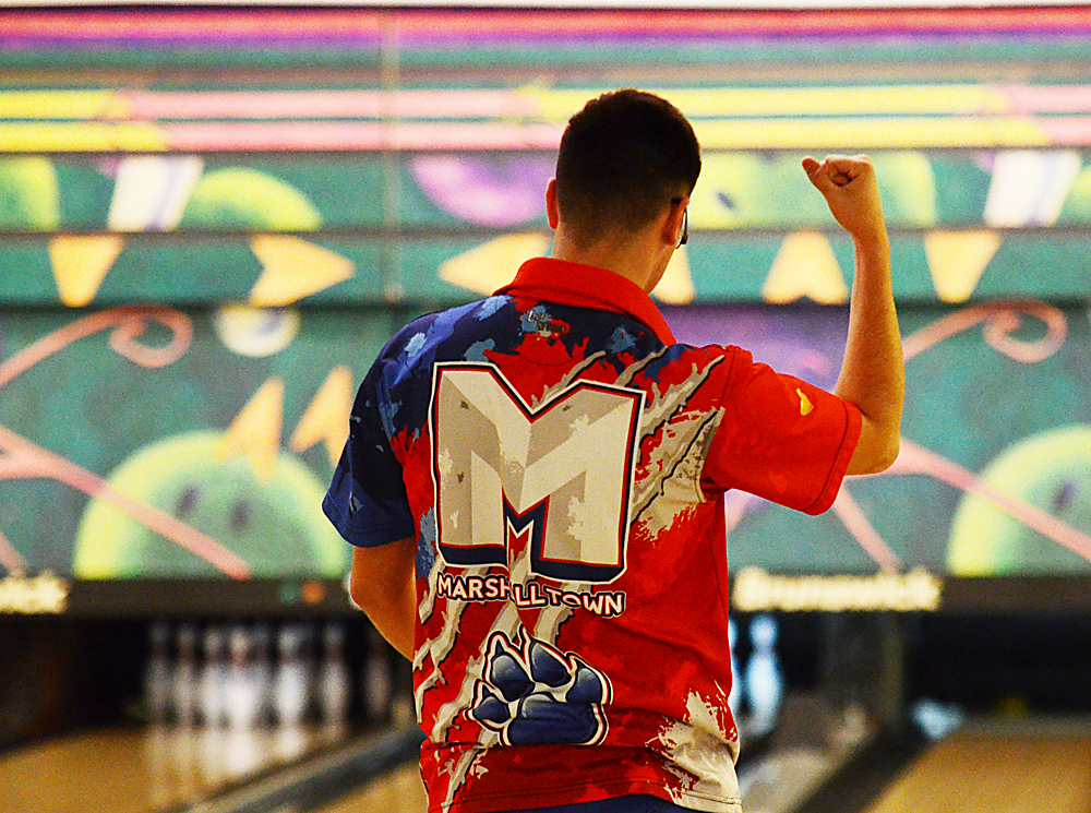 T-R photo by Stephen Koenigsfeld Junior Richie Thomas reacts after earning a strike during one of his individual frames Tuesday. Thomas rolled a 397 series and the Bobcats won the Class 3A District 6 meet with 3,429 pins.