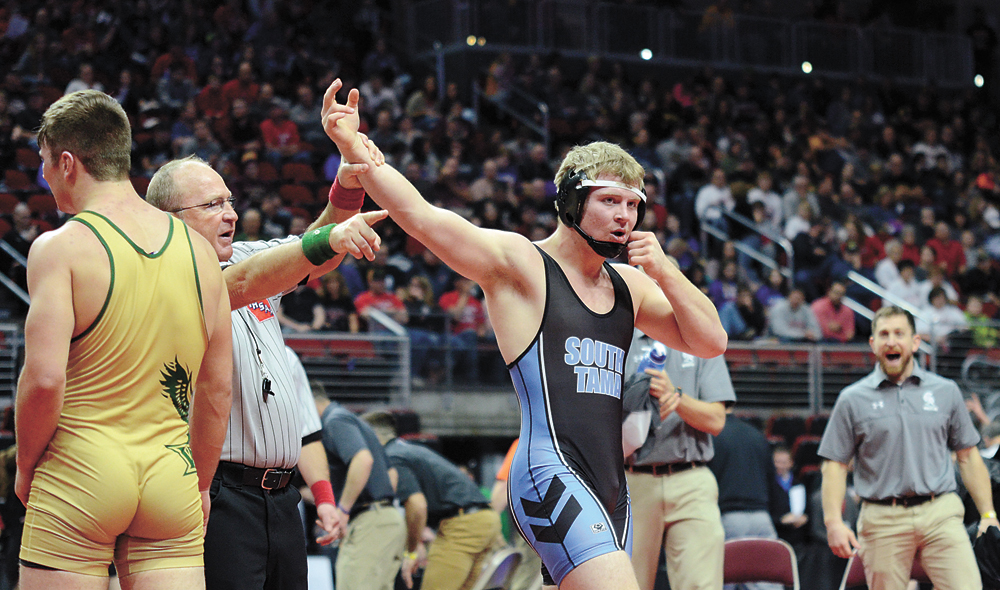 T-R PHOTO BY STEPHEN KOENIGSFELD • South Tama County's Dalton Rosenburg has his hand raised by the official after upsetting Class 2A No. 2 Tanner Vermaas in the 182-pound first round. Rosenburg held on for a 4-1 decision.