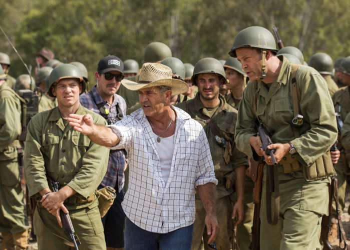 "AP PHOTO This image released by Summit shows director Mel Gibson, center, and actor Vince Vaughn on the set of the film, ""Hacksaw Ridge."" Gibson is nominated for an Oscar for best directing for his work on the film."
