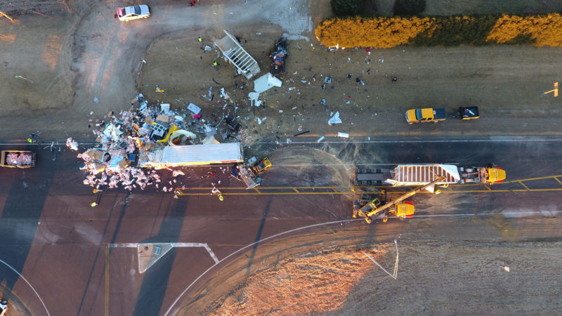 CONTRIBUTED PHOTOS Two people were killed in an early morning accident north of Marshalltown at the intersection of Highways 14 and 96. The Iowa State Patrol said a pickup traveling westbound on Highway 96 failed to stop at the stop sign and collided with a northbound semi-truck. That semi then spun out and was struck by a southbound semi-truck.