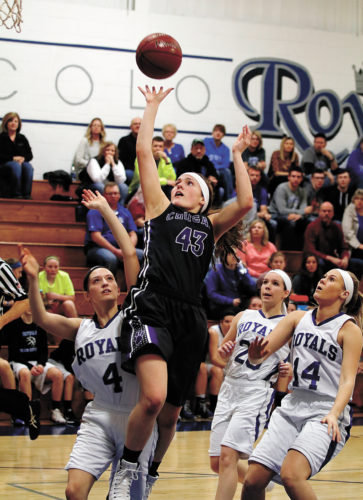 T-R PHOTO BY ADAM RING • AGWSR's Mariah Jimmerson (43) goes in for a basket ahead of Colo-NESCO's Lauryn Hill (4), Chelsea Henze (20) and Kassie Robinson (14) in Friday's Class 1A Region 3 semifinal in Colo. AGWSR won 67-38, advancing to Monday's region final against Turkey Valley.
