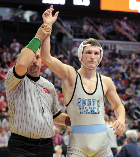 T-R PHOTO BY STEPHEN KOENIGSFELD • South Tama County's Isaac Judge is declared winner after upsetting No. 1 Joe Kelly (West Liberty) in the Class 2A 152 quarterfinals on Friday. Judge defeated No. 4 John Tuttle to advance to the 152 finals.