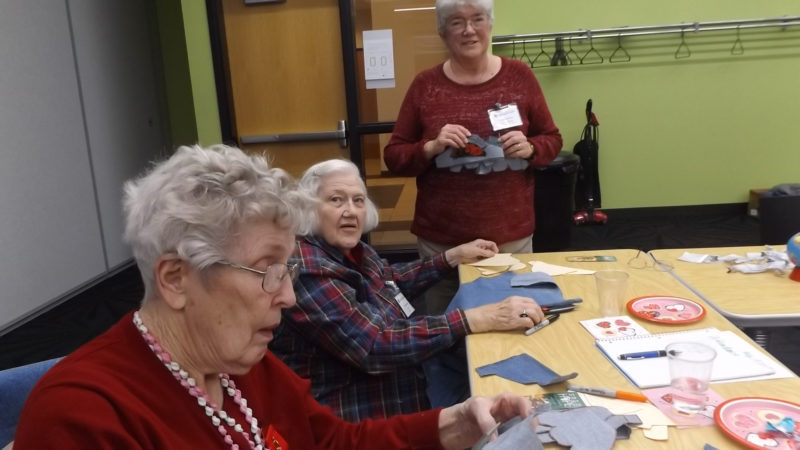 CONTRIBUTED PHOTO The Delta Kappa Gamma members pictured, left to right: Alta Bolhoefer, Mary Schendel and Bonnie Bradbury worked on cutting shoe forms from material to be sent to Uganda for assembly by local workers hired by Sole Hope.