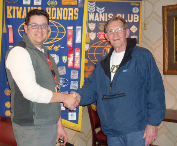 CONTRIBUTED PHOTO Kiwanis P.M. President Kenny Lamb, right, welcomes eighth grade teacher Steve Hinderhofer who gave a program on his vision for cultivating Miller Middle School green space.