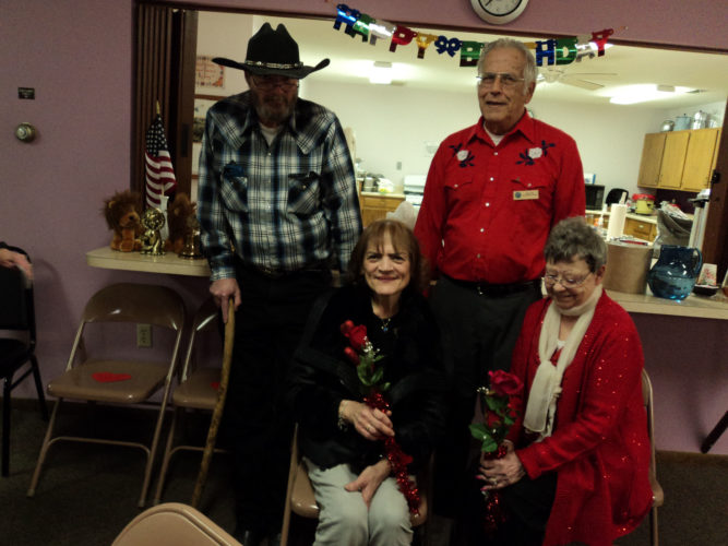 CONTRIBUTED PHOTO Valentine couples Mike Slater and Kathy Kippe, and Bob and Dianne Maile were serenaded by Lioness Martha Fisher in honor of Valentine's Day.
