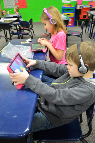 T-R PHOTO BY CHUCK FRIEND The BCLUW school district is featured in a new Iowa Association of School Boards' video promoting SAVE funding. The funds helped purchase iPads like these being used by two first-grade students.