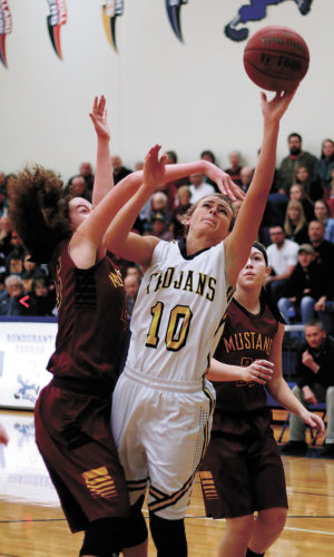 T-R PHOTO BY ADAM RING • West Marshall's Brooke Snider (10) has her shot contested by PCM's Kaylee Townsend in the first quarter of Saturday's Class 3A Region 8 final in Bondurant. PCM blocked a potential game-tying shot attempt to take the 52-49 win and advance to the state tournament.