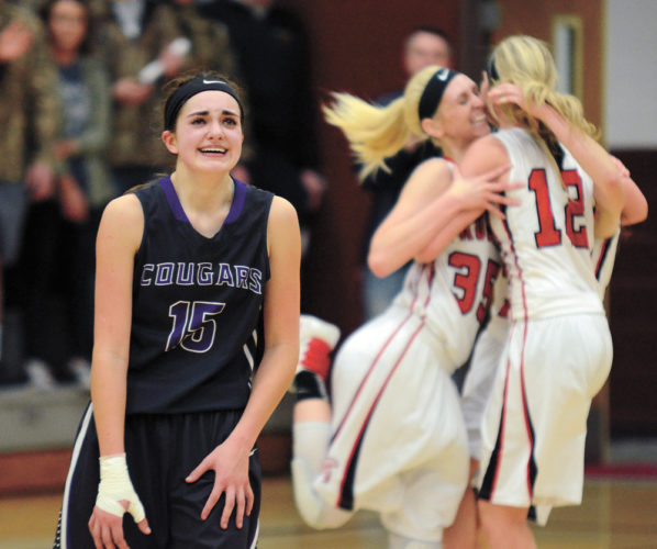 T-R PHOTO BY STEPHEN KOENIGSFELD • AGWSR junior Mandy Willems fights back her emotions as she walks away from the jubilant Turkey Valley girls' basketball team and the 2016-17 season. The 14th-ranked Cougars lost to No. 2 Turkey Valley 48-33 on Monday night in the Class 1A Region 3 final.