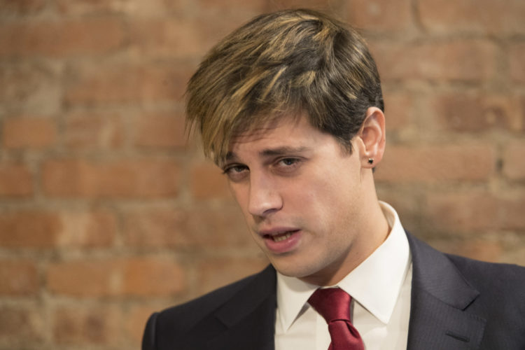 AP PHOTO Milo Yiannopoulos speaks during a news conference, Tuesday, in New York.  Yiannopoulos has resigned as editor of Breitbart Tech after coming under fire from other conservatives over comments on sexual relationships between boys and older men.
