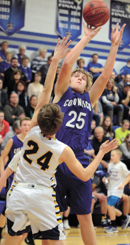 T-R PHOTO BY STEPHEN KOENIGSFELD • Colo-NESCO junior Jacob Clatt (25) shoots for two of his team-leading 17 points over Hudson's Jacob Murray during Tuesday's Class 1A District 6 semifinal in Reinbeck. Clatt and the Royals advanced with a 47-44 victory against the Pirates.
