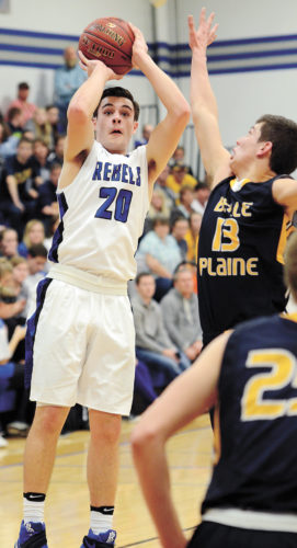 T-R PHOTO BY STEPHEN KOENIGSFELD • Gladbrook-Reinbeck senior guard Joe Smoldt (20), shoots a jumper over Belle Plaine defender Garrett Straight (13) during the second half of Tuesday's Class 1A District 6 semifinal in Reinbeck. Smoldt scored 28 points to lead the fourth-ranked Rebels to an 89-75 win.