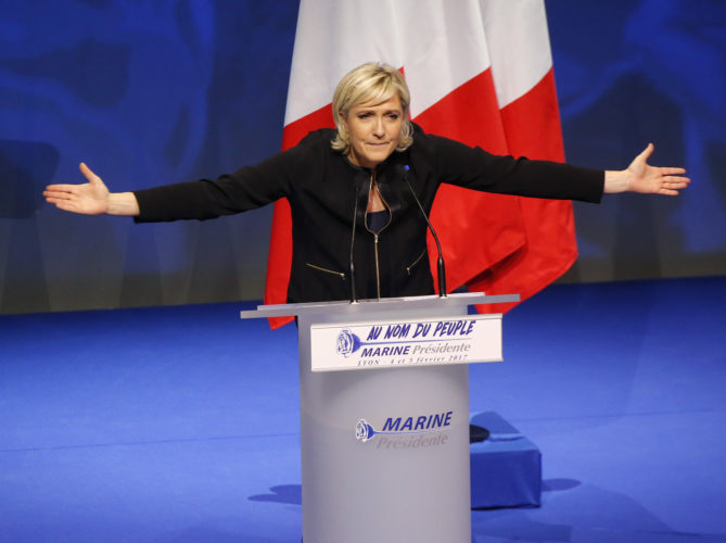 AP PHOTO In this Feb. 5, file photo, Far-right leader presidential candidate Marine Le Pen gestures as she speaks during a conference in Lyon, France.