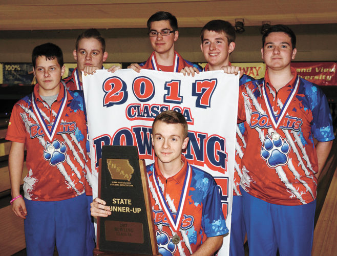 T-R PHOTO BY STEPHEN KOENIGSFELD • The Marshalltown boys' bowling team poses with its runner-up banner and trophy Wednesday after the Class 3A state meet at Plaza Lanes in Des Moines. Zachariah Liskowiak holds the trophy in front while, from left: Ray Wiegand, Carson Potter, Richie Thomas, Joshua Arment and Kamrin Chizik hoist the banner.