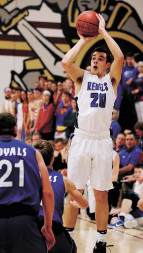 T-R PHOTO BY ADAM RING • Gladbrook-Reinbeck's Joe Smoldt puts up a 3-point shot attempt against Colo-NESCO in the first quarter of Thursday's Class 1A District 6 final in Grundy Center. Smoldt scored 37 points, including six 3-pointers, guiding the Rebels to a 64-56 win.