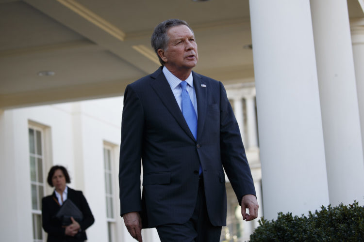 AP PHOTO Ohio Gov. John Kasich walks out of the White House in Washington, Friday, to speak with reporters following a meeting with President Donald Trump.