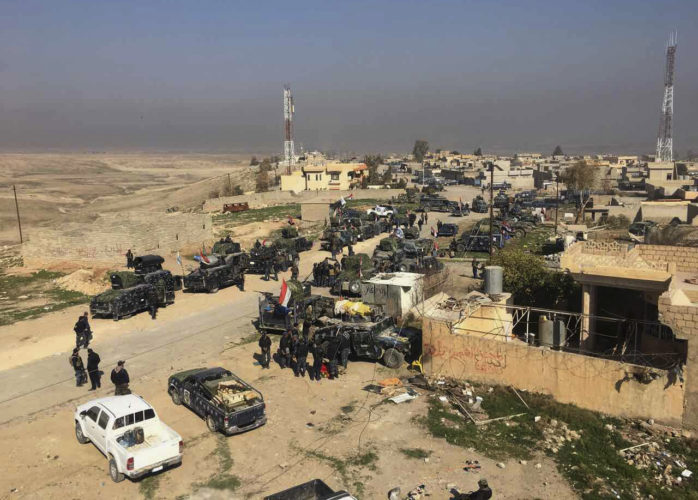 AP PHOTO Iraqi Federal police forces advance towards the western side of Mosul, Iraq, Thursday. The advance comes as part of a major assault that started five days earlier to drive Islamic State militants from the western half of Mosul, Iraq's second-largest city.