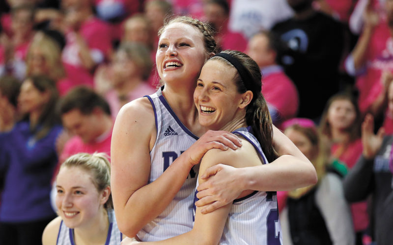AP PHOTO • Drake seniors Lizzy Wendell and Caitlin Ingle, right, hug at the end of a Missouri Valley Conference women's basketball game against Northern Iowa on Friday night at the Knapp Center in Des Moines. Wendell scored a game-high 21 points and Ingle added nine points and eight assists in the No. 21 Bulldogs' 70-57 win, clinching the MVC regular-season title outright for the first time since 2000.