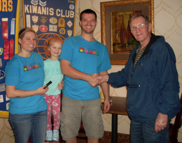 CONTRIBUTED PHOTO Kiwanis P.M. President Kenny Lamb welcomes Joanna and Derek Timmer and family, owners of Let's Play Bounce inflatable game area.