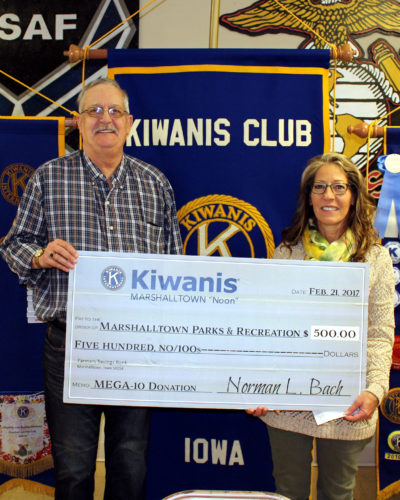 """CONTRIBUTED PHOTO Kiwanis """"Noon"""" member Mike Gowdy presented a check to Park and Rec Director Anne Selness for the MEGA-10 Park upgrades."""