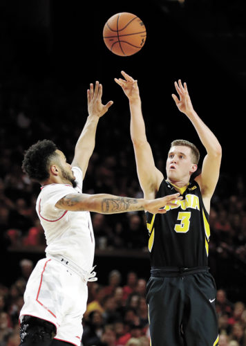 AP PHOTO • Iowa guard Jordan Bohannon, right, shoots over Maryland's Jaylen Brantley during the first half of an NCAA college basketball game Saturday in College Park, Md.