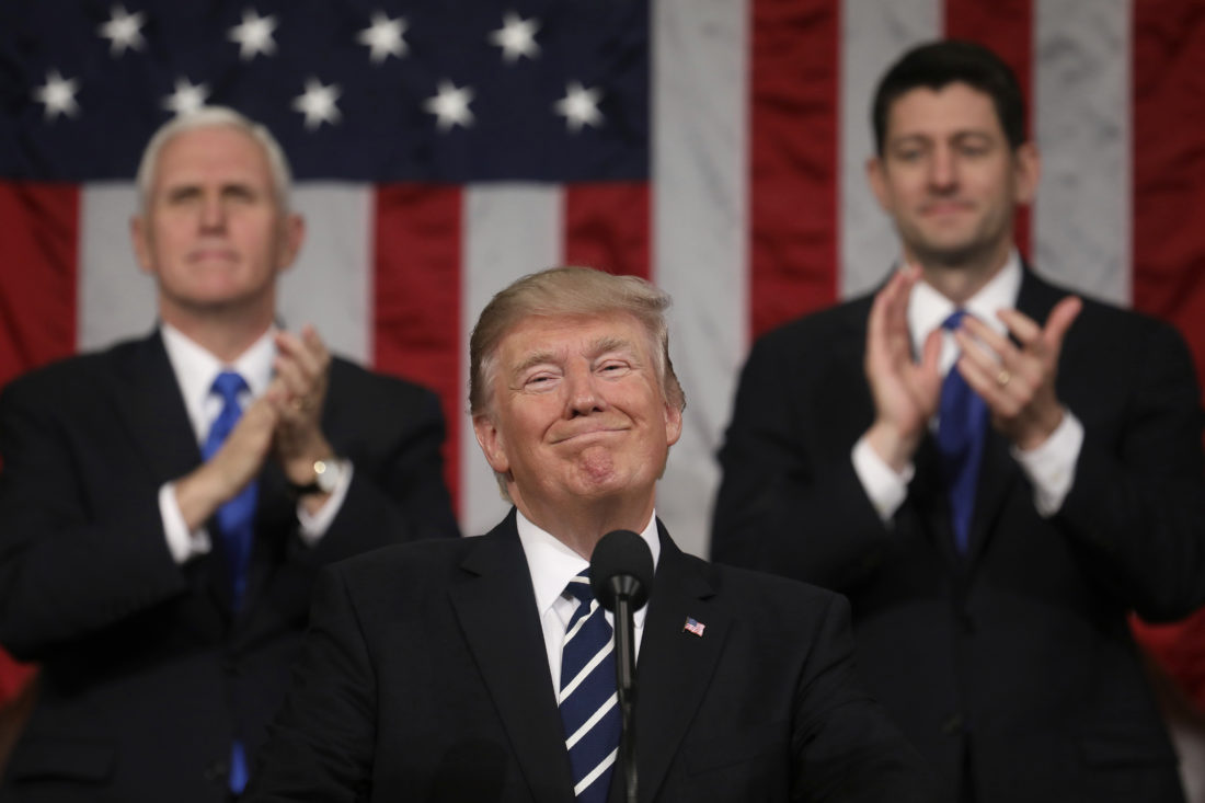 AP PHOTO President Donald Trump addresses a joint session of Congress on Capitol Hill in Washington, Tuesday, as Vice President Mike Pence and House Speaker Paul Ryan of Wis., applaud.