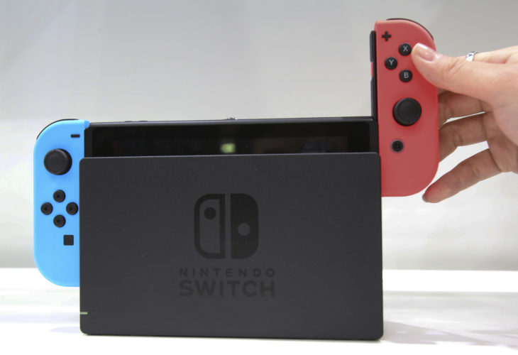 AP PHOTO In this Jan. 13 file photo, a model puts the controller onto the Nintendo Switch during a presentation event in Tokyo.