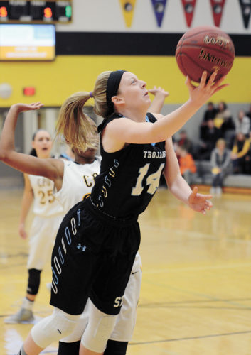 T-R FILE PHOTO • South Tama County sophomore Jess Musgrave (14) tries for two points during the Trojans' loss to Center Point-Urbana in the Class 3A regional semifinals Feb. 15 in Center Point.