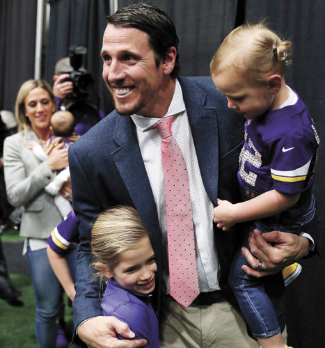 AP PHOTO • Minnesota Vikings linebacker Chad Greenway holds his daughter Blakely, 2, as he gives a hug to another daughter, Beckett, 6, following a press conference where he announced his retirement Tuesday in Eden Prarie, Minn.