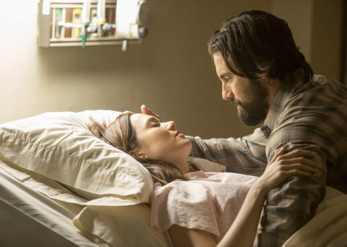 "This image released by NBC shows Mandy Moore, left, and Milo Ventimiglia in a scene from ""This Is Us."" The season finale for the popular  time-twisting family drama will air Tuesday at 9 p.m. EST on NBC. (Ron Batzdorff/NBC via AP)"