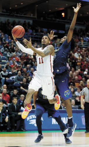 AP PHOTO • Iowa State's Monte Morris (11) goes up for a shot against Nevada's Lindsey Drew during the first half of an NCAA Tournament first-round game Thursday at the BMO Harris Bradley Center in Milwaukee.