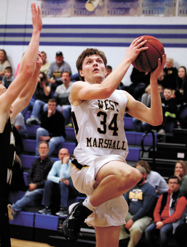 T-R PHOTO BY ADAM RING • West Marshall's David Disney drives to the basket in the second half of the NICL Senior All-Star games Friday night in Reinbeck. Disney won the dunk contest after completing a 360-degree slam.