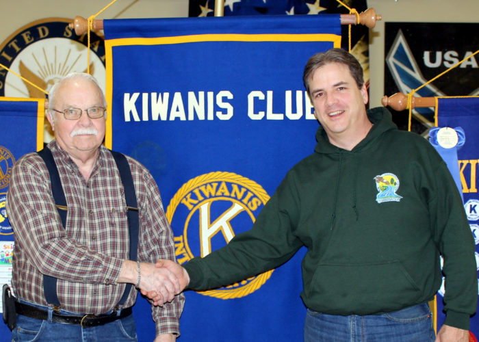 CONTRIBUTED PHOTO Noon Kiwanis member Ken Smith welcomes Marshall County Conservation Director Mike Stegmann who shared special upcoming events with the club.