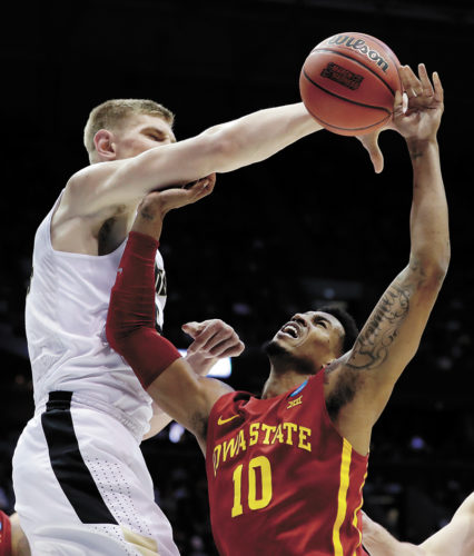 AP PHOTO • Purdue's Isaac Haas blocks a shot by Iowa State's Darrell Bowie (10) during the first half of a men's NCAA Tournament second-round game Saturday night in Milwaukee. Haas had 14 points as the Boilermakers beat the Cyclones 80-76.
