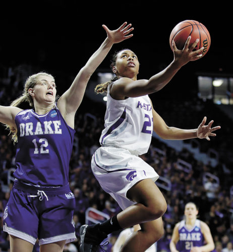 AP PHOTO • Kansas State's Karyla Middlebrook gets past Drake's Brenni Rose (12) for a layup during the first half of a first-round game in the women's NCAA Tournament on Saturday in Manhattan, Kan.