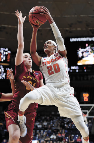 AP PHOTO • Syracuse's Brittney Sykes, right, attacks the basket against Iowa State's Bridget Carleton in the first half of a first-round game in the women's NCAA Tournament on Saturday in Storrs, Conn.